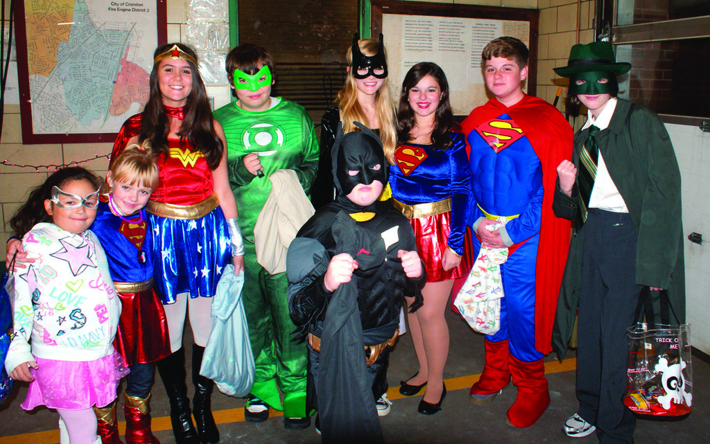 THE JSUTICE LEAGUE: A group of friend dressed as members of the Justice League from the comics enjoyed their time at the Cranston Fire Headquarters on Pontiac Avenue. Pictured from left are Unique Montalvo, Emily Newton, Jessica Santuri, Alex Barnes, Issie Nagy, Gabby DiBoni, Nicholas Okerholm and Keenan Dunleavy. Leading the pack is Justin Okerholm as Batman.