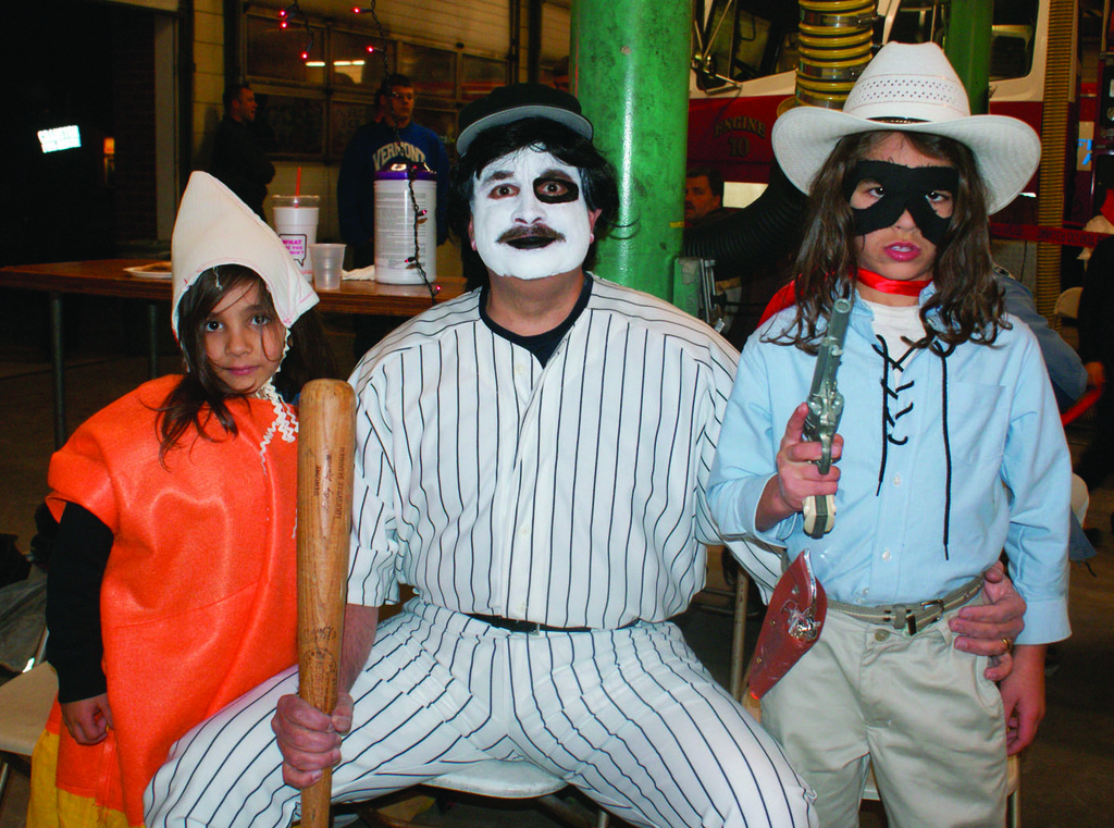 "A FAMILY FRIGHT: The Kevorkian family arrived at the party with Bedros as candy corn, Allan Sr.  as ""Baseball Fury"" and Allan Jr. as the Lone Ranger."