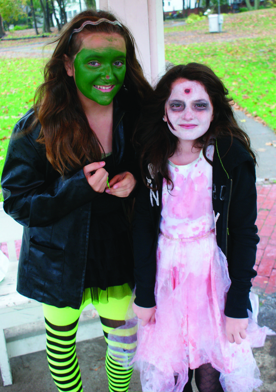 WITCHES AND ZOMBIES CAN BE FRIENDS: Leah Marsich of Cranston dressed as the witch poses with her friend Tessa Keough of Warwick.