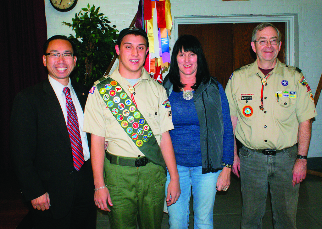 SOARING TO EAGLE: Mayor Allan Fung, Eagle Scout Michael Falco, his mother Roberta Falco, and Scoutmaster Paul Kelley of Troop 22 celebrate during a ceremony held in honor of Falco becoming the 57th Eagle Scout from the Troop.