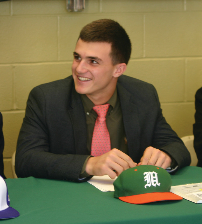 REASON TO SMILE: Tom Pannone, who will be playing baseball at the University of Miami next year, waits to sign his letter of intent on Wednesday.