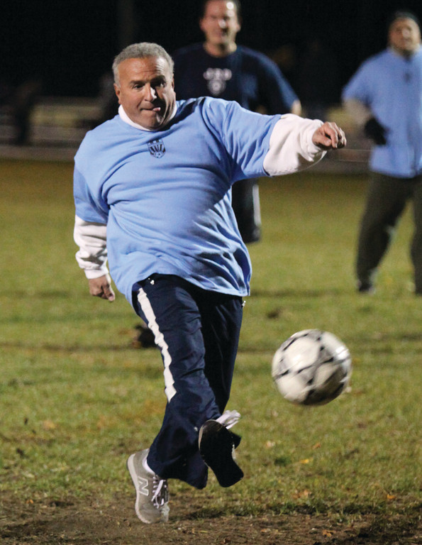 North Providence Mayor Charles Lombardi attempts a penalty shot at the end of the first half of play.