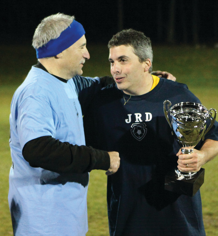 Mayor Joseph Polisena congratulates Jack Plouffe of the coaches' team after the coaches' 4-2 victory at the second annual Mayor's Cup soccer game on Friday evening. Admission to the event was free, but proceeds from the concession stand benefit the Johnston Youth Soccer Association.