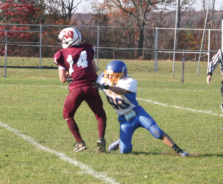 Steve Amalfitano drags down quarterback Brett Bouchard.