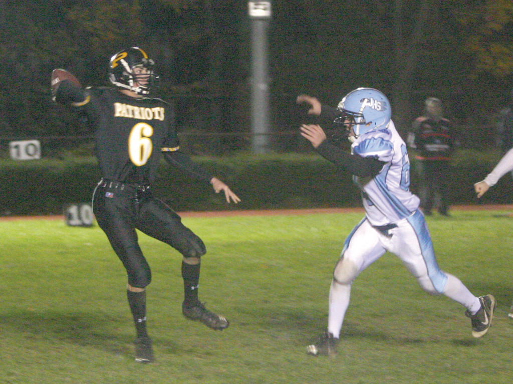 DROPPING BACK: Pilgrim quarterback Lee Verrier gets off a pass under pressure in Friday's game against Johnston. Both teams had just missed out on the playoffs. Johnston won 36-12.