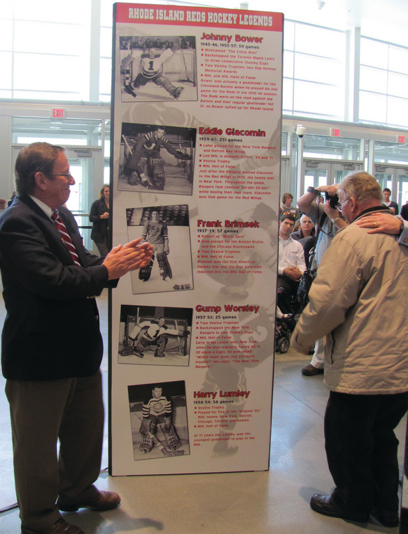 EXHIBIT A: Bill O�Connor, a member of the Rhode Island Reds Heritage Society, admires part of the display that was unveiled Sunday and will be housed in the Dunkin Donuts Center.