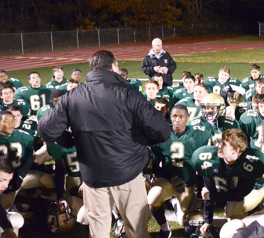 ONE MORE: Hendricken freshman football coach Jonathan Stringfellow addresses his team after last week's semifinal victory. The Hawks play for the freshman championship on Saturday.