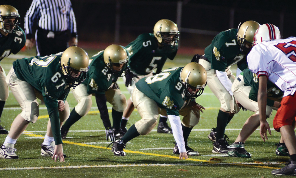 GETTING IT DONE: The Hendricken offensive line gets set for a play.