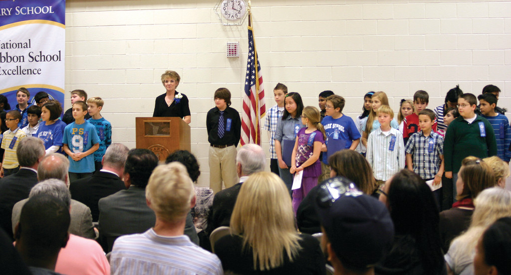 PROUD SCHOOL: Park Elementary students flank their principal, Marilyn Feeney, as she welcomes the audience to celebrate the school's recognition of being named a National Blue Ribbon School, one of only two in the state, during a ceremony Monday afternoon.