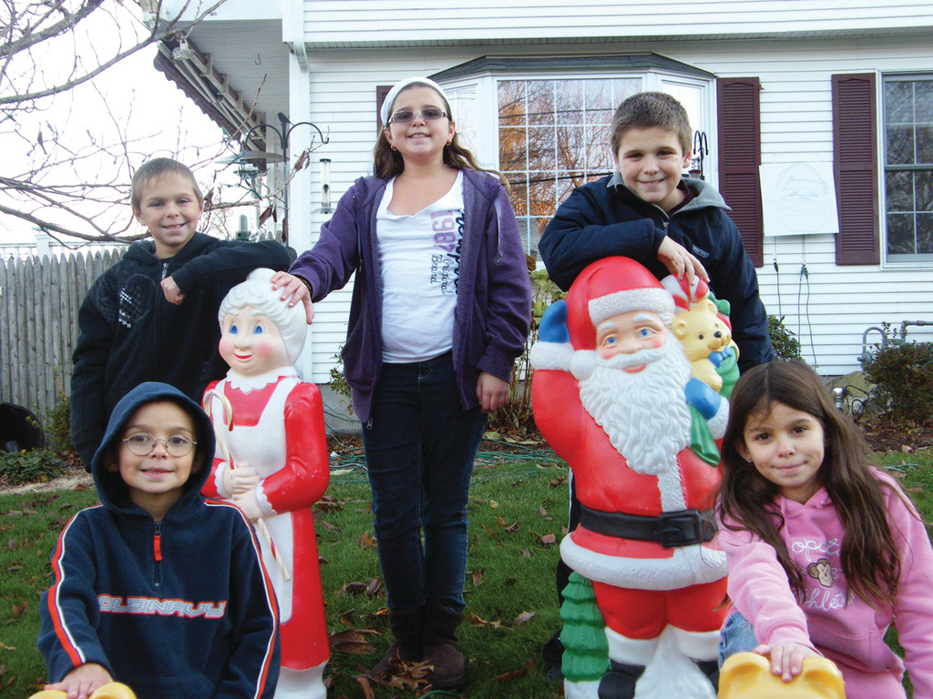 LEWIS FAMILY: The Lewis children enjoy decorating their home on Shenendoah, following in the footsteps of a decorating tradition their father started 15 years ago. Front row: Michael and Allie age 10. Back row from left: Michael, 9, Abby, 14 and Everett IV, 12.