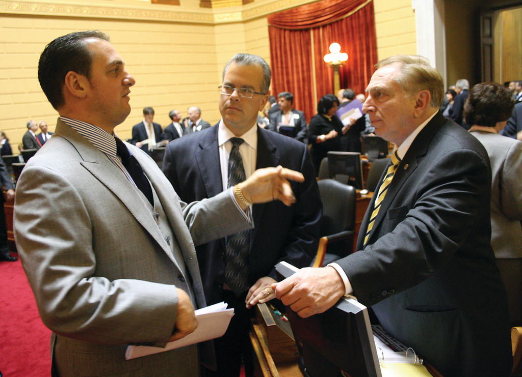 IT'S AN ITALIAN THING: Rep. Peter Petrarca, left, of Lincoln and Rep. Joseph Trillo express their opinions in words and gestures over the need to address municipal pension plans with Rep. Nicholas Mattiello looking on as a special session of the General Assembly convened Thursday.