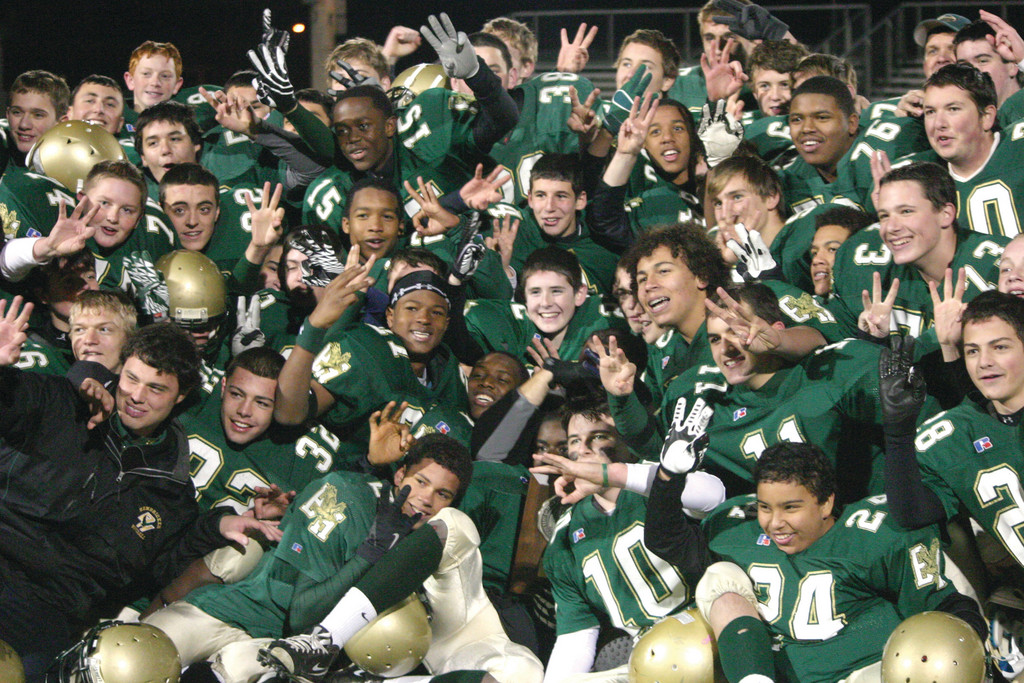 CHAMPS AGAIN: The Hendricken freshman football team poses for photos after winning the Super Bowl on Saturday at Cranston Stadium. The Hawks came back from a 6-0 hole to beat Barrington 36-18. It's the freshman team's third straight title.