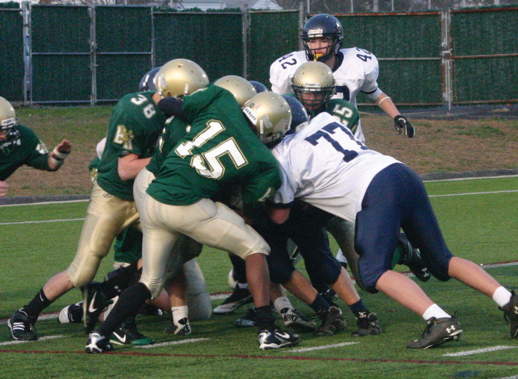 WINNING PLAY: The Hendricken defense makes a gang tackle.
