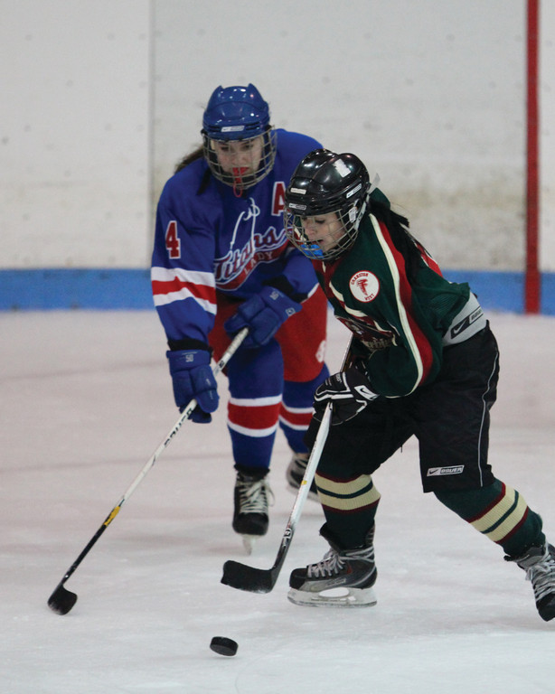 Emma Hindinger fights for control of the puck.