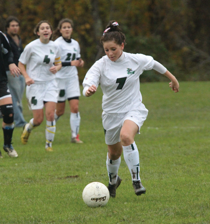 HONORED: Caitie McGarry dribbles up the field.