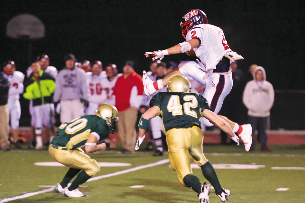 MEMORIES: Toll Gate's Doug Johnson hurdled two Hendricken players on his way to a touchdown in the 2008 Thanksgiving Eve game. This year's match-up is the 40th meeting between the schools.