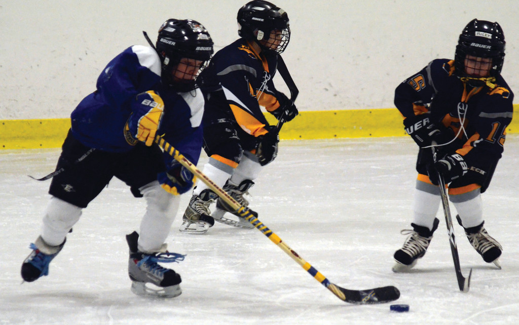 D.J. Pickens carries the puck into the zone in the Mite Jamboree.