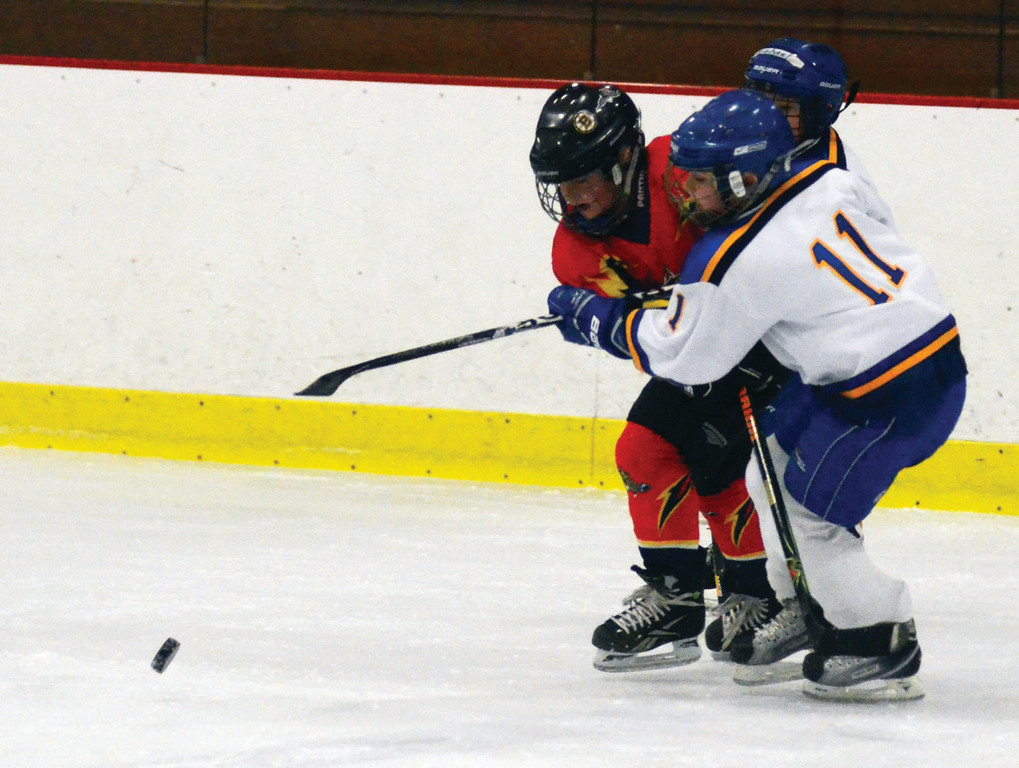 Camden Palumbo battles for possession for the Squirt Blue team.