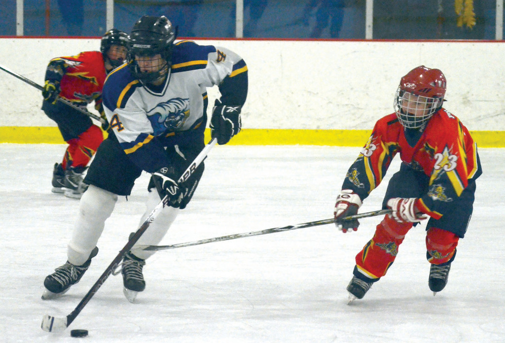 Michael Sylander makes a move around a defender for the PeeWee team.