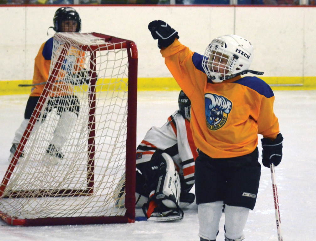 Josh Calvino celebrates a goal in the Mite Jamboree.