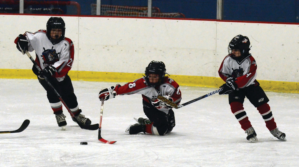 Anthony Saccoccio, Ernesto Watsky and Jack Hannan try to corral a loose puck.