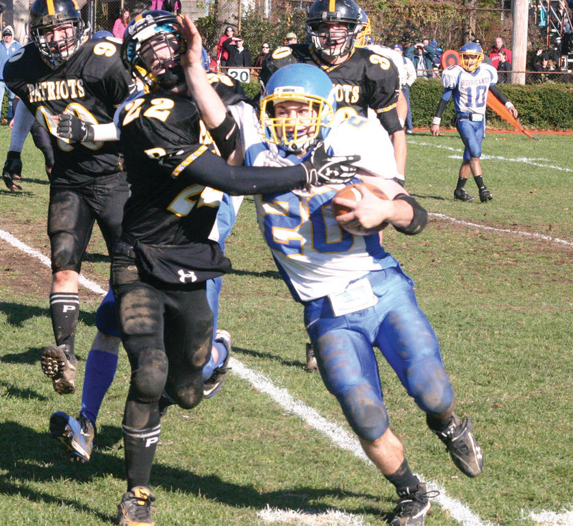 RUNNING WILD: Vets' T.J. Boyajian (right) stiff-arms Pilgrim's Jon DeVito during the 'Canes 21-14 win over the Pats on Thanksgiving Day. Boyajian finished the game with 170 yards on the ground and Vets snapped a two-game losing streak to Pilgrim.