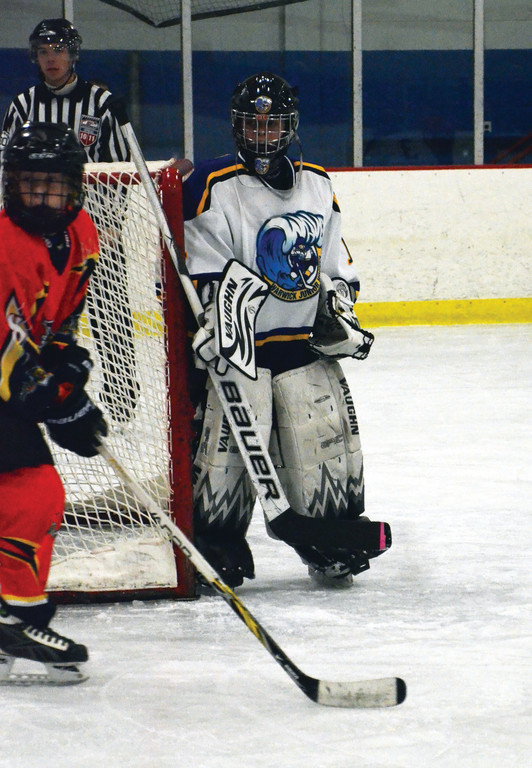 PeeWee goalie Benjamin Meunier gets set.