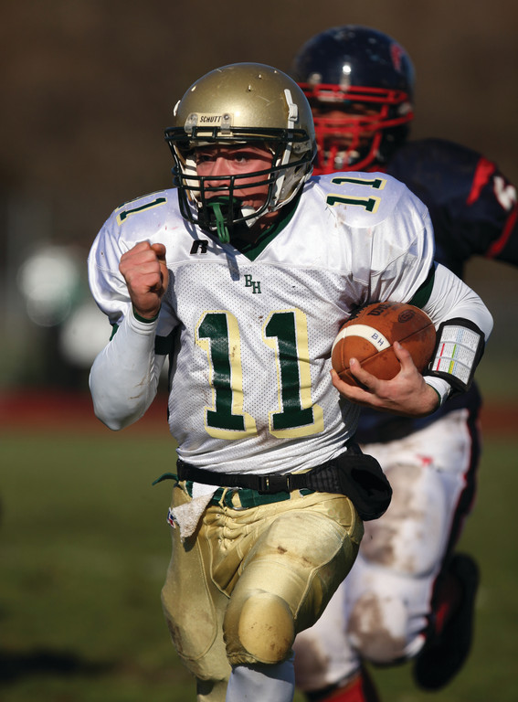 Hendricken quarterback Ryan Brannigan breaks loose on a long run.
