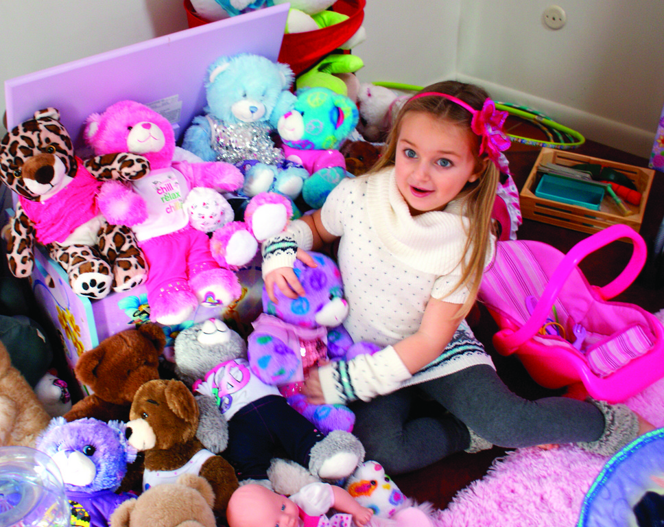 BUILD A BEAR, BUILD A CAREER: One of Isabella's favorite toys to play with are her Build-A-Bears that she made with family and friends. She is pictured at home relaxing this past weekend. She is currently in kindergarten.