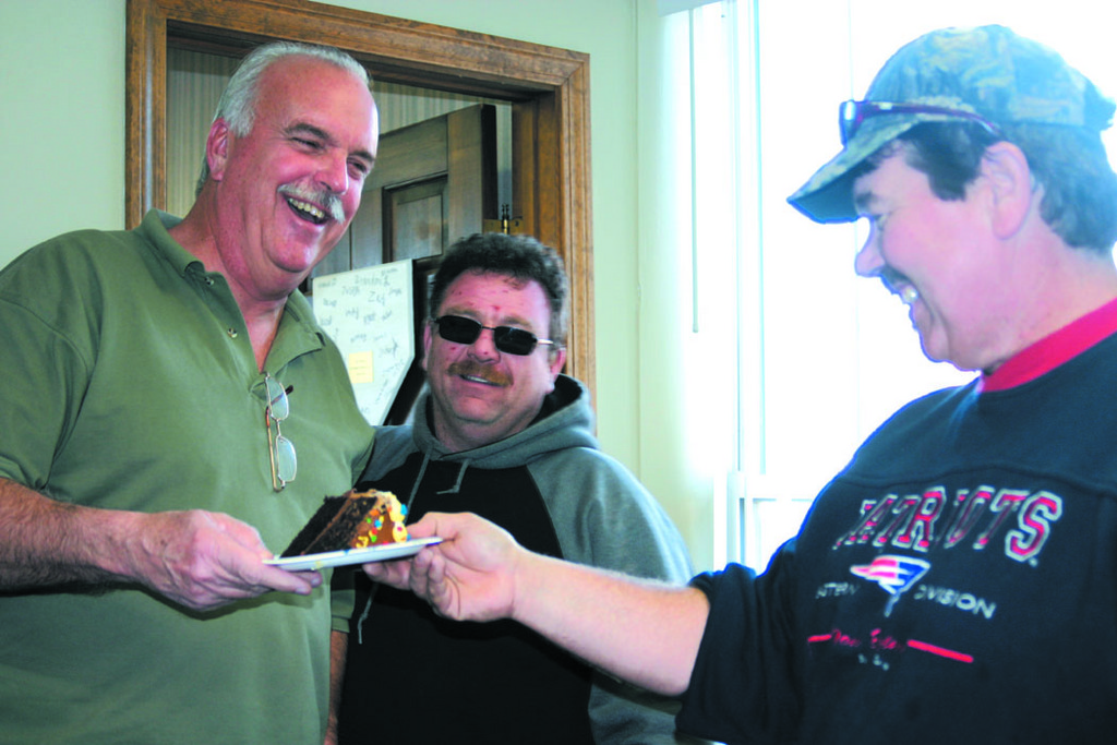 THE CALM AFTER THE STORMS: After 37 years of employment at the Department of Public Works, Mike Weber has retired from his job as the acting highway chief. Yesterday, his co-workers held a send-off party for him, complete with a cake that featured a dump truck. Weber, (left) along with Dan Conley and Jerry Parker enjoy a laugh.