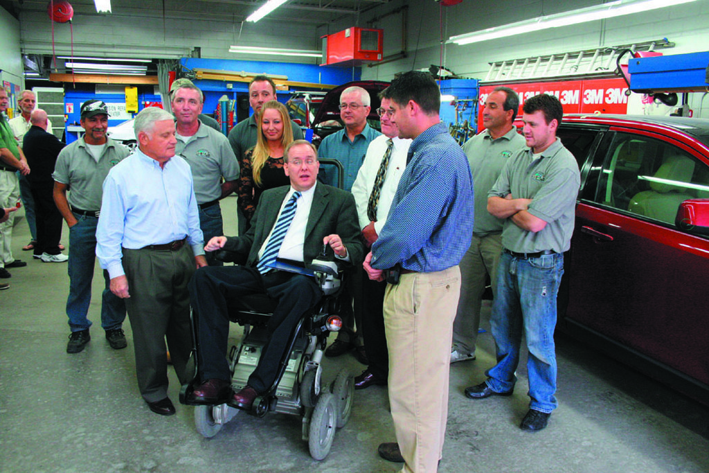 REVVED UP FOR THE FUTURE: Congressman Jim Langevin (left) visited Rick's Auto Body at 62 Post Road in Warwick for a tour and a discussion about how they can solve the state's unemployment problem and train more people in the automotive industry. He also presented owners Ronald D. Piscione (center) and his father, Ronald J. Piscione, with a Certificate of Special Congressional Recognition for 50 years of service.