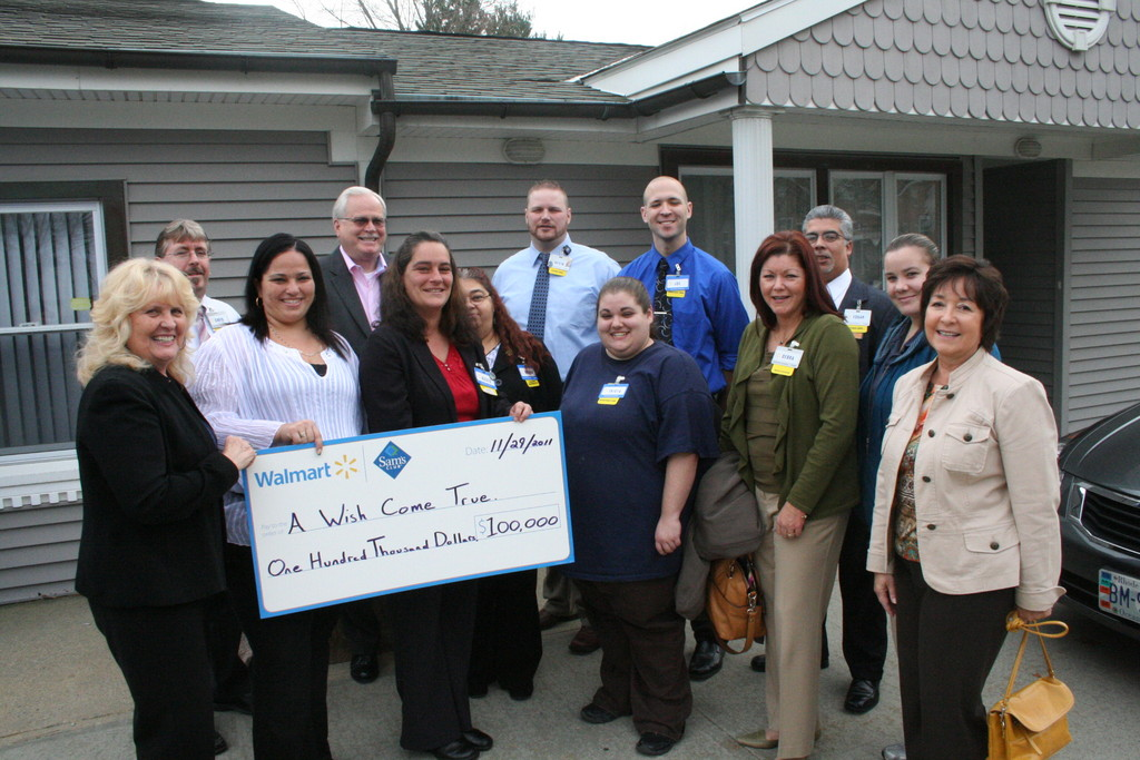 "CHECKING IT OFF THEIR ""WISH"" LIST: A Wish Come True founder and executive director Rosemary Bowers (left), along with Alexis Tulli and Tina Heyder and other Wal-Mart representatives celebrate the $100,000 donation."