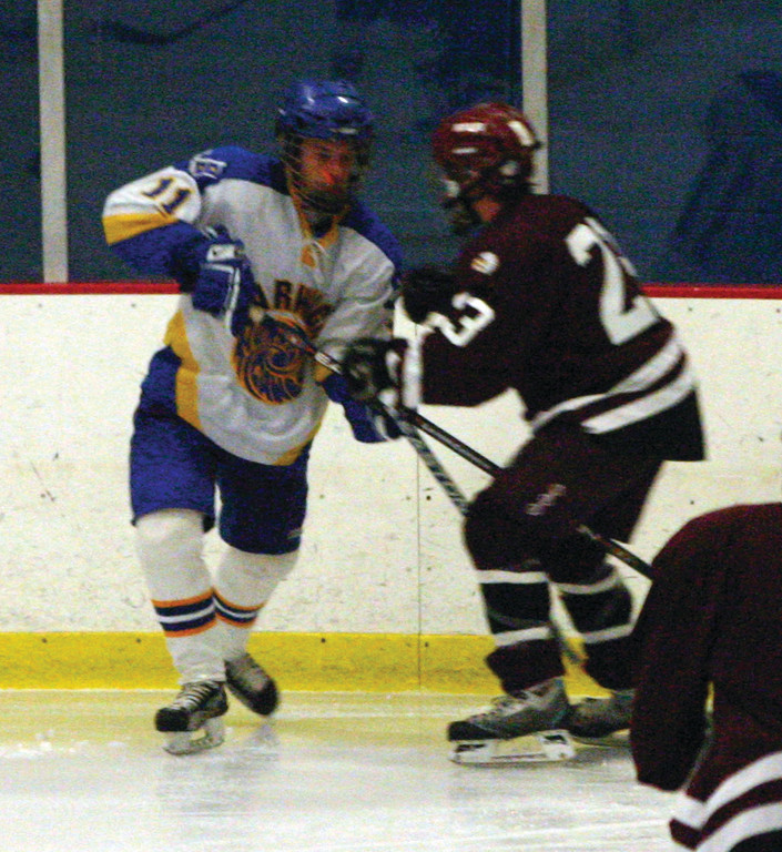 ALL OVER THE ICE: Vets' Dan Pickering (left) will be counted on to play almost the entire game from his spot at defense.