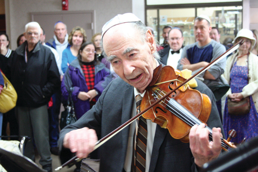 NOTEWORTHY PERFORMANCE: Sam Chester performs the song he composed last week for his wife Esther at a ceremony Sunday at Temple Am David.