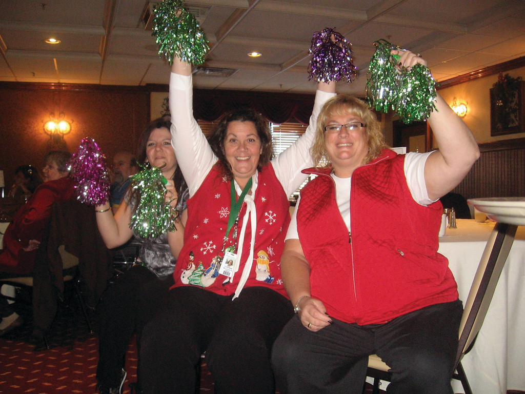 CHEERLEADERS: Morgan employees such as Melissa Prevey, Administrator; Eva Pecchia who handles social services; and Corinne McLaughlin, Director of Nursing, rooted for their team with enthusiasm.