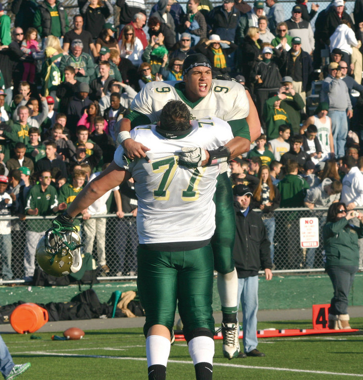 JUMP AROUND: Max Heintzelman (77) and Jarrid Witherspoon celebrate the victory.