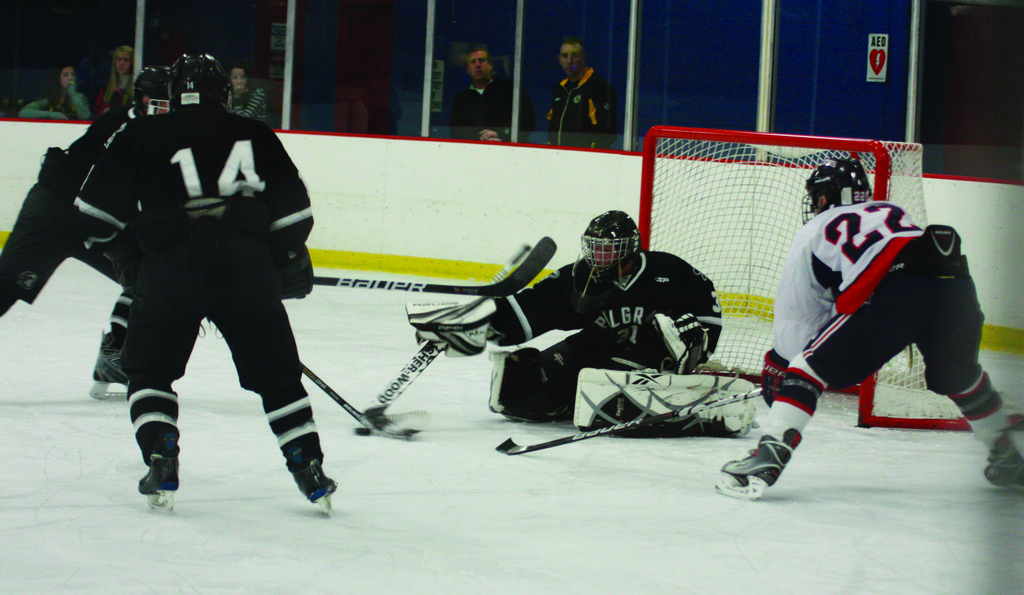 ALL OUT: Pilgrim goalie Devon Gamba knocks a puck out of the crease.