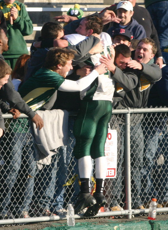 BACK FOR MORE: Hendricken quarterback Ryan Brannigan (middle) celebrates his team's Super Bowl victory on Saturday with some members of last year's Super Bowl-winning team.