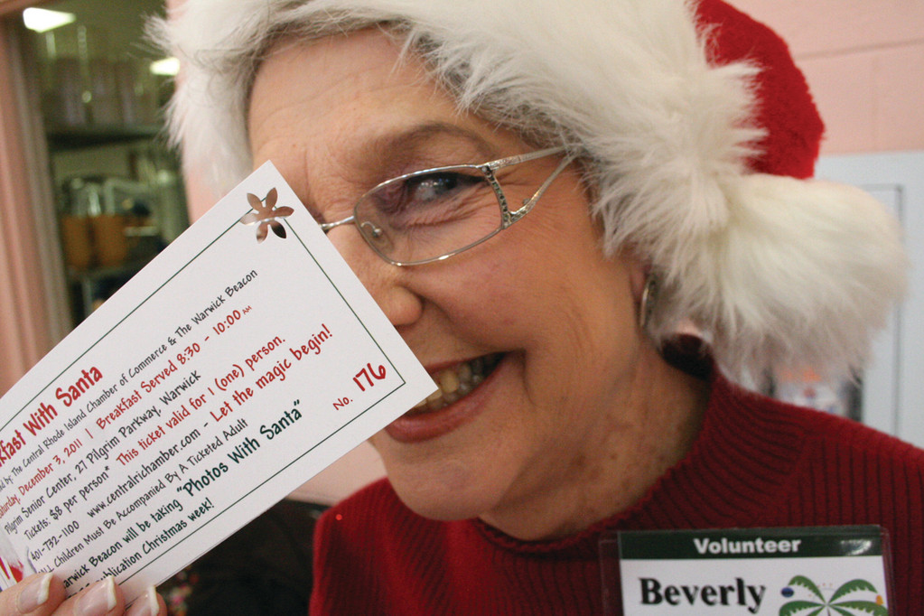 Saturday's breakfast and photos with Santa included a bit of juggling, not to mention some tricks from Chamber members. Here, Beverly Levitt-Narciso holds a punched ticket.