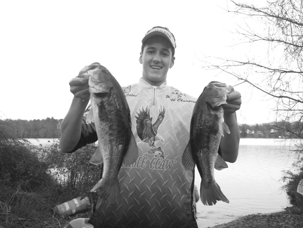 Chris Catucci of Warwick, with two of the 20 bass he caught last week at Warwick Lake.
