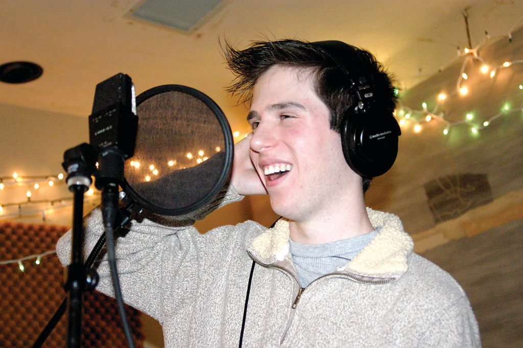 HOLIDAY SPIRIT: The recording booth at Lakewest Recording has been modestly festooned with Christmas lights, perhaps to get Jesse Liam in the mood for a seasonal concert for Toys for Tots at the Warwick Mall on Sunday.