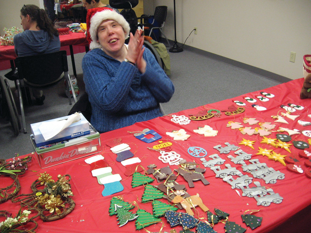 HAPPY HELPER: West Bay Residential Services, Inc. held their first annual holiday bazaar on Friday and sold quality handmade items, most of which were produced by people West Bay supports through its residential and day service programs. Gloria Bray, 42, said she had a blast making and selling wooden ornaments.