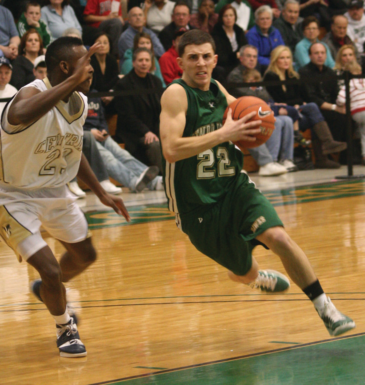 GOING STRONG: Hendricken's Corey Palumbo drives to the basket during a game last season. Palumbo and the Hawks will be aiming high after seeing their state title streak end last season.