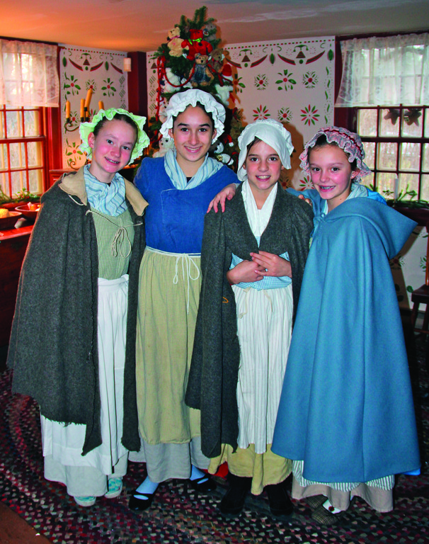 HISTORY IN THE RE-MAKING: The Smith-Appleby House in Smithfield hosted a Colonial holiday event Sunday, complete with volunteers in period costumes, a visit from Santa and hearthside cooking.