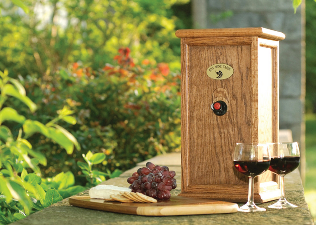 DRINK UP!: While his 17.5-inch oak box wine caddies aren�t sold in the store, Bob McVay and his family sell their locally made product online at http://www.boxwinecaddy.com.