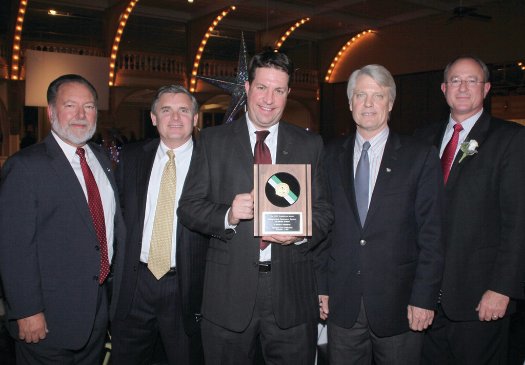 BUSINESS CHAMPION: Bob Slocum, Sean Donaghey, Mike Dacey, Bob Hartnett and Mark Male display the Business Champion award presented to the Warwick-based Independent Insurance Agents of Rhode Island.