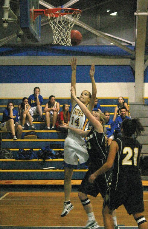 Kristen Gregory shoots over the Pilgrim defense.