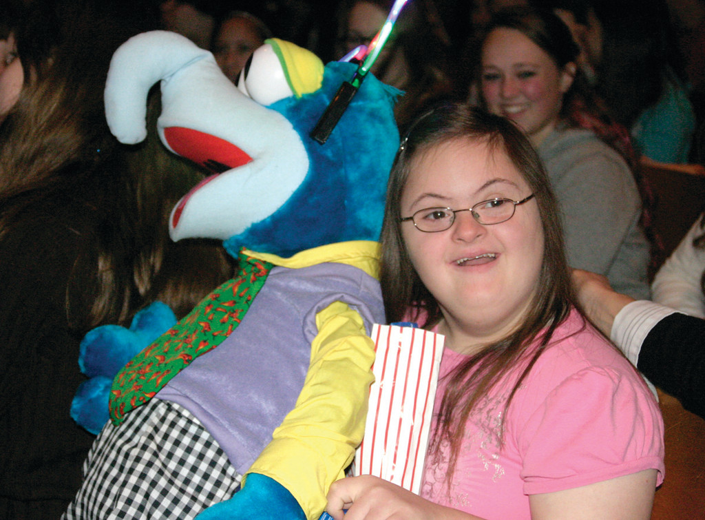 MERRY MUPPET: Kayleigh Maloney, 19, a developmentally disabled senior, was chosen to receive a special prize, a bright faced Gonzo plush toy.
