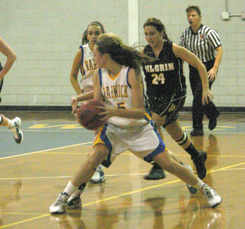 HELPING THE CAUSE: Emily Almonte looks for a passing lane after picking up her dribble.