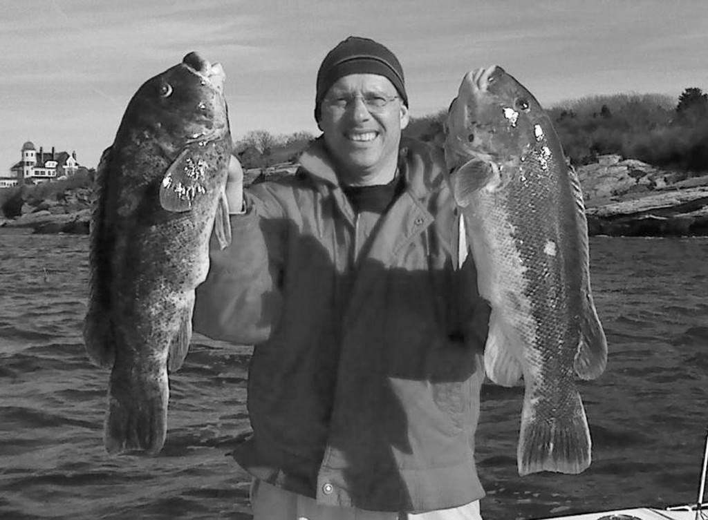 Michael Casey, a member of the Rhode Island Saltwater Anglers Association, poses with an eight- and a 10-pound tautog he caught last week in the Brenton Tower area.
